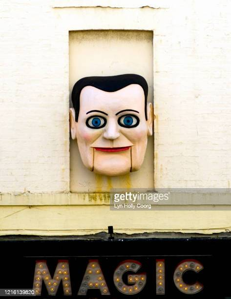 magic puppet face on wall - lyn holly coorg stock pictures, royalty-free photos & images