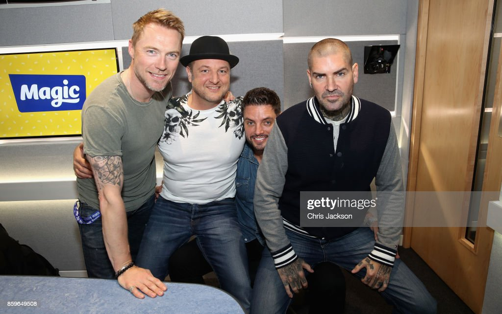 Magic Radio Breakfast presenter Ronan Keating poses with Keith Duffy, Mikey Graham and Shane Lynch on October 10, 2017 in London, England. Boyzone are visiting Magic Radio Breakfast as they are set to reunite in 2018 to mark their 25th anniversary. They are also paying tribute to fellow Boyzone member Stephen Gatley today on the 8th anniversary of his death in 2009.
