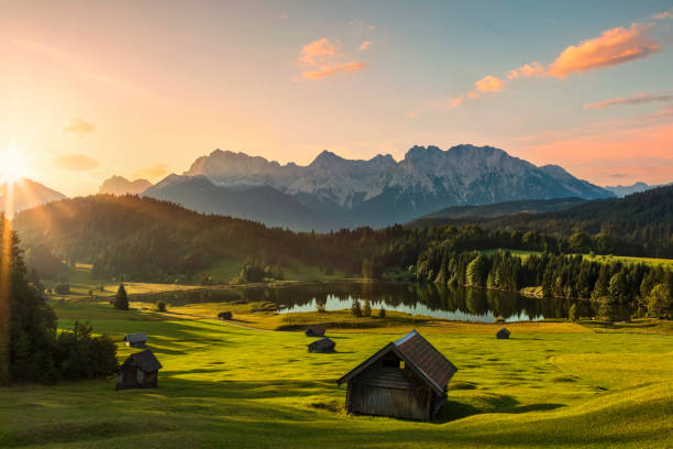 magic sunrise at alpine lake geroldsee - view to mount karwendel, garmisch partenkirchen, alps - germany stock pictures, royalty-free photos & images
