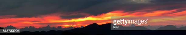 Magic Sunrise Moment, Dramatic Red and Golden Cloud with long, unbroken stretch of mountains