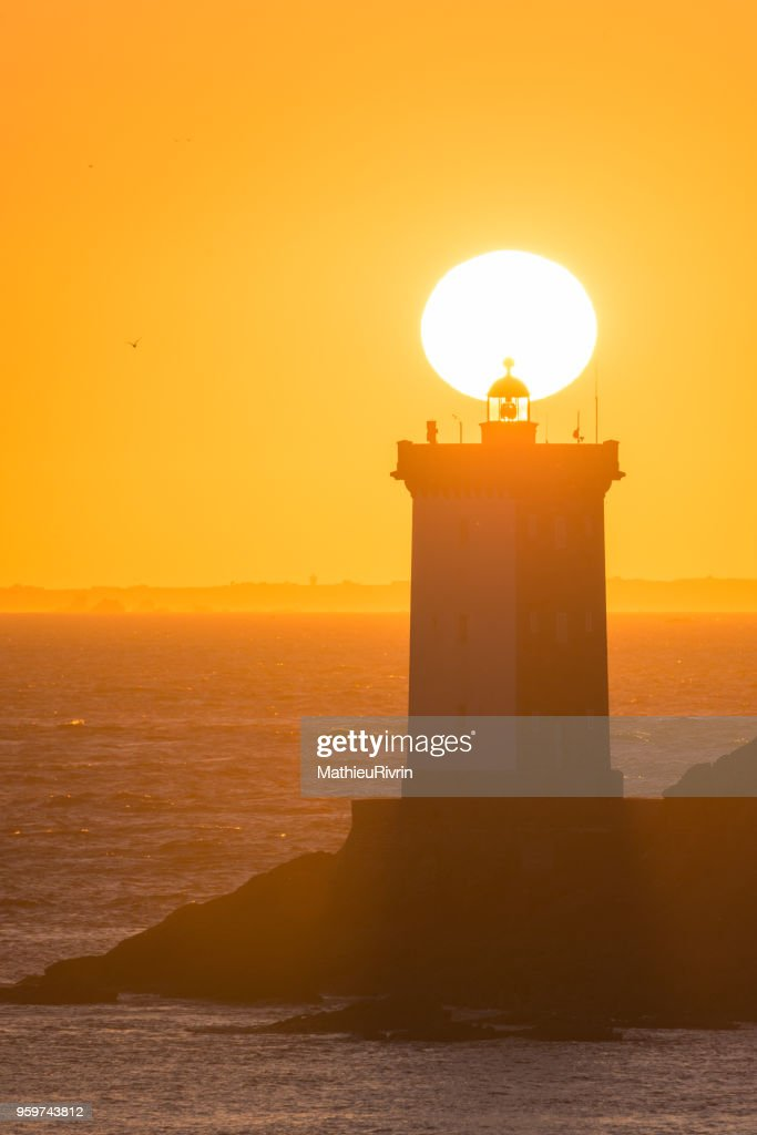 Magic sunset in Le Conquet behind the lighthouse : Stock Photo