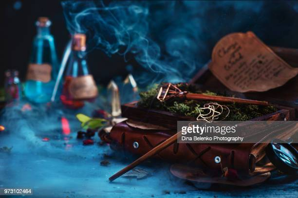 magical bubble wands in a wooden case. modern witch workplace with potions, scrolls, crystals and smoke. conceptual still life with copy space. - wizard stock pictures, royalty-free photos & images