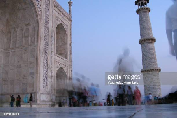 magical ethereal atmosphere after sundown near taj mahal white marble mausoleum in agra, india - www picture com stock photos and pictures