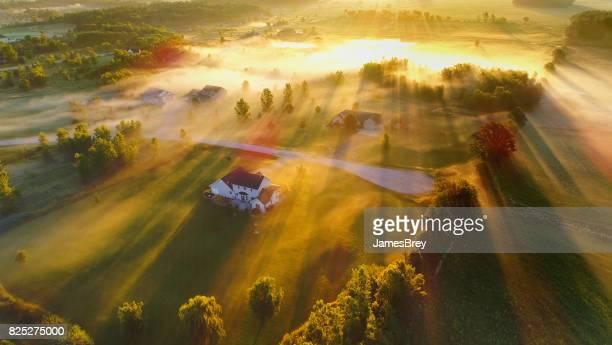 Magical foggy landscape at dawn, aerial view.
