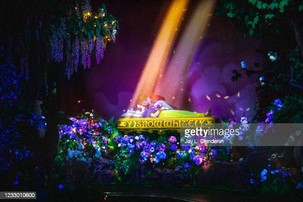 Magical forest scene shows Prince Charming delivering True Loves kiss, awakening Snow White from the Evil Queens spell, on Snow Whites Enchanted Wish...