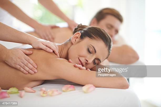 magical hands soothing their muscles - husband massage wife stock photos and pictures