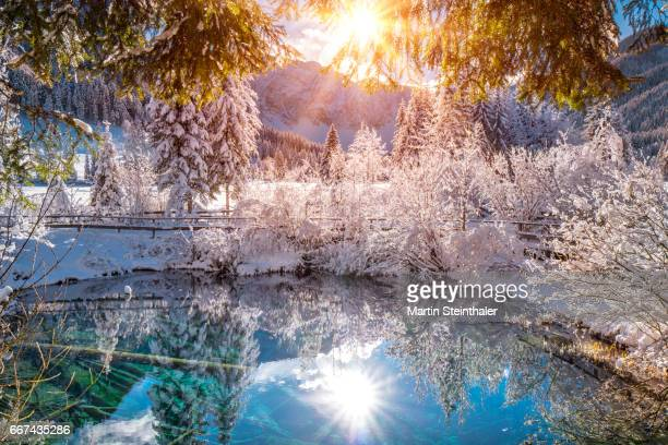 magical lake in winter with warm sun reflections - mirror lake stock pictures, royalty-free photos & images