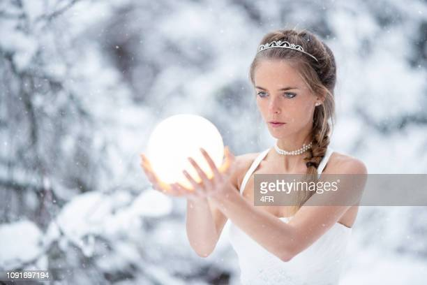 magical snow princess holding a glowing ball in her hands, frozen fairy tale - snow moon stock pictures, royalty-free photos & images