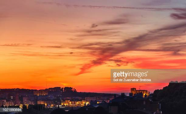 Magical sunset with sky tinted in red by the sun in Castro Urdiales, Cantabria.