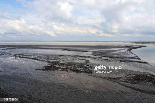 magical tidal phenomenon on french atlantic beach - light natural phenomenon stock pictures, royalty-free photos & images