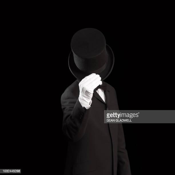 magician and black top hat - top hat stock pictures, royalty-free photos & images