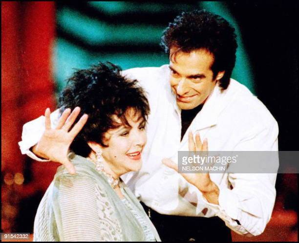 Magician and illusionist David Copperfield performs a magic trick with actress Elizabeth Taylor during taping of the upcoming television special...