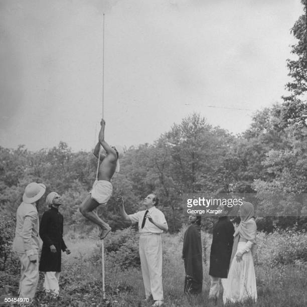 Magician and psychic investigator Joseph Dunninger demonstrating phony Indian rope trick