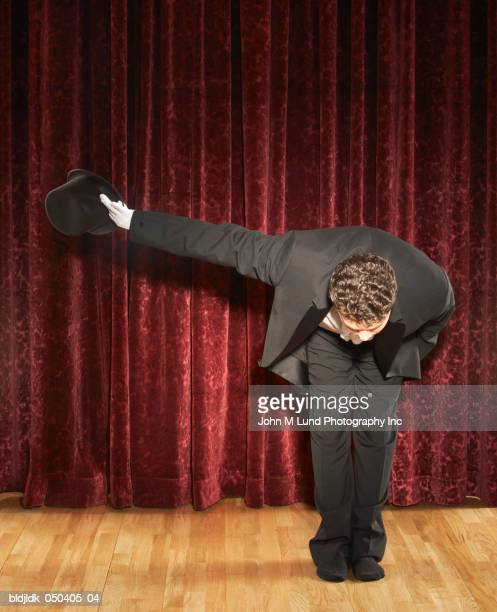 magician bowing on stage - お辞儀 ストックフォトと画像