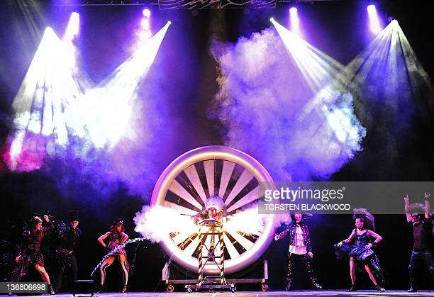 Magician Brett Daniels performs his turbine act during the preview for the world premiere of 'The Illusionists' at the Sydney Opera House on January...