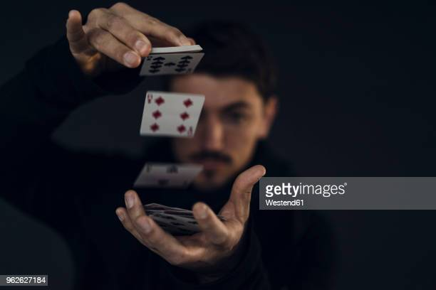 magician conjuring with playing cards, close-up - magician stock pictures, royalty-free photos & images