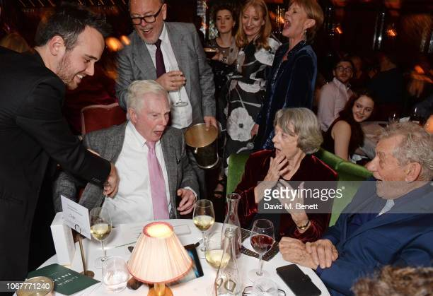 Magician Dan Farrant performs for Sir Derek Jacobi Dame Maggie Smith and Sir Ian McKellen at the annual 'One Night Only At The Ivy' in aid of Acting...