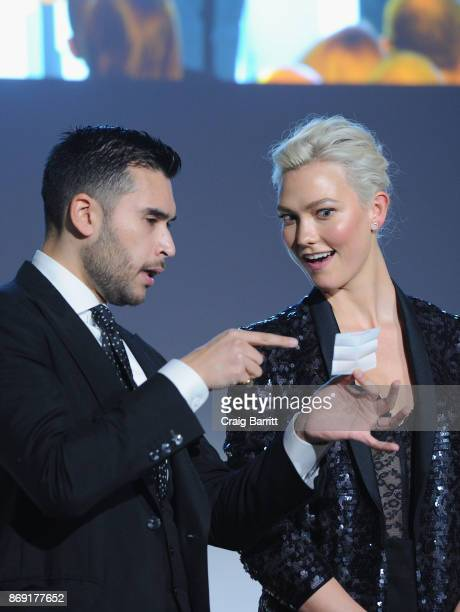Magician Dan White performs onstage with model Karlie Kloss the WSJ Magazine 2017 Innovator Awards at MOMA on November 1 2017 in New York City