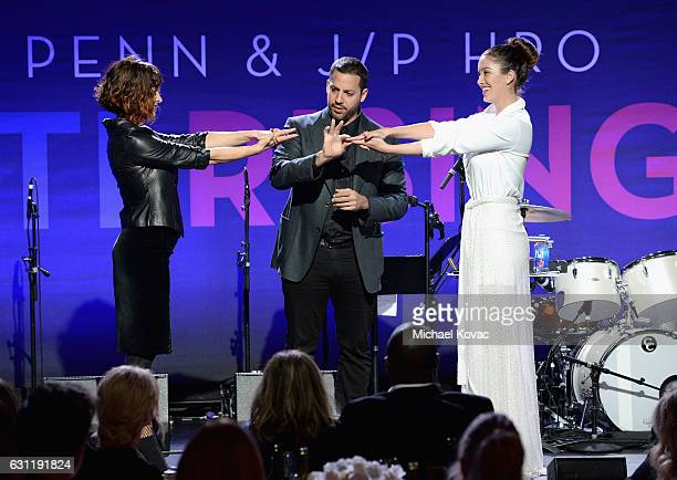 Magician David Blaine and actress/model Melissa Bolona perform onstage during the 6th Annual Sean Penn & Friends HAITI RISING Gala Benefiting J/P...