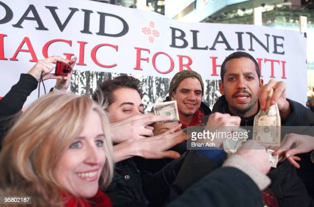 Magician David Blaine performs to help raise money for Haitian earthquake victims on Military Island Times Square on January 15 2010 in New York City