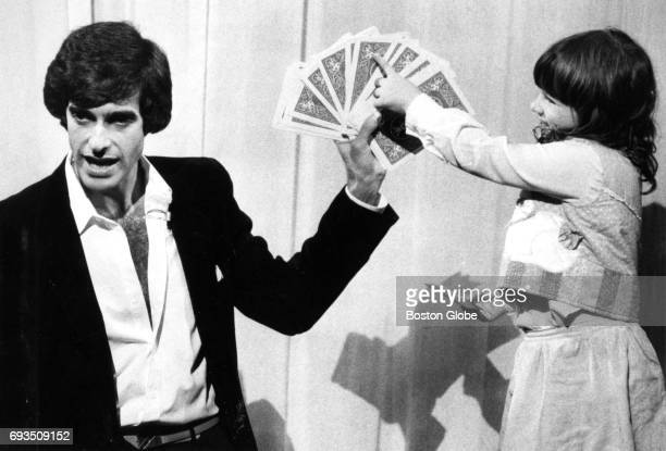 Magician David Copperfield allows Laura an audience participant to select a card during his performance at the Wilbur Theatre in Boston on Oct 2 1984