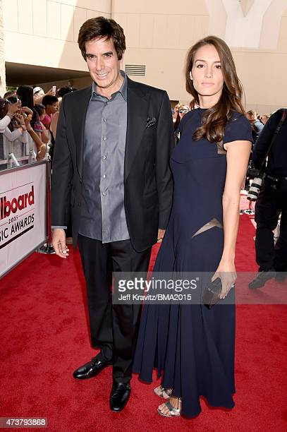 Magician David Copperfield and Chloe Gosselin attend the 2015 Billboard Music Awards at MGM Grand Garden Arena on May 17 2015 in Las Vegas Nevada