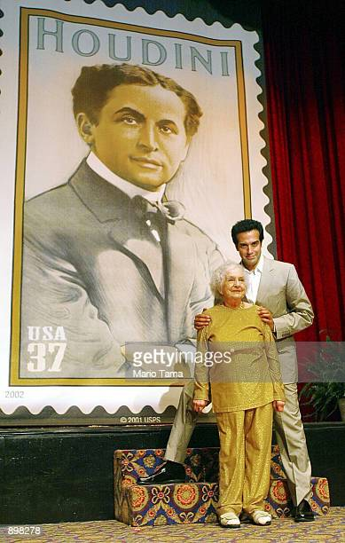 Magician David Copperfield and Marie Blood niece of Harry Houdini attend the unveiling of the Harry Houdini 37cent postage stamp at the Society of...