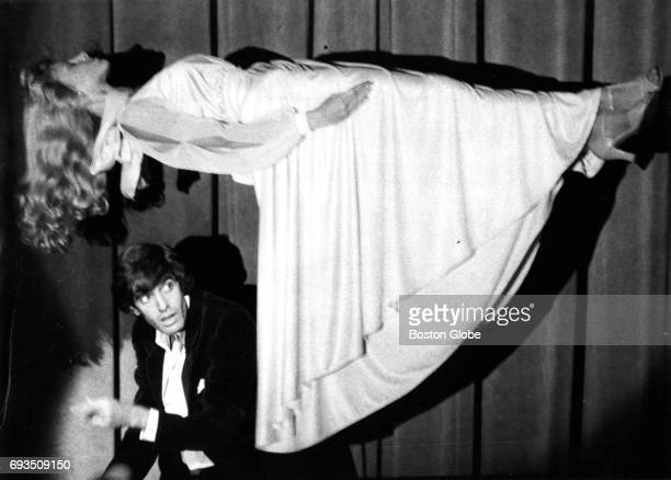 Magician David Copperfield performs as his assistant is elevated from the floor at the Wilbur Theatre in Boston on Oct 2 1984