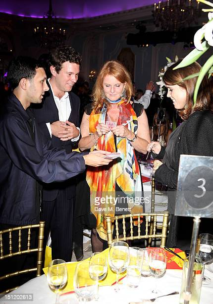 """Magician Dynamo performs tricks for Jack Brooksbank, Sarah Ferguson, Duchess of York and Princess Eugenie of York at the second annual """"Freddie For A..."""