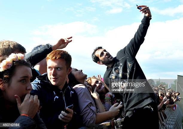 Magician Dynamo takes selfies with the crowd on day 1 of the Parklife Weekender Festival at Heaton Park on June 7 2014 in Manchester England