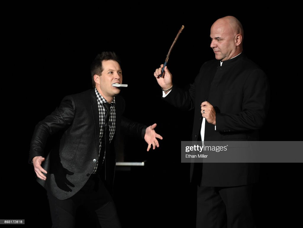 Magician Farrell Dillon (L) performs with an audience member during opening night of 'Masters of Illusion' at Bally's Las Vegas on December 13, 2017 in Las Vegas, Nevada.