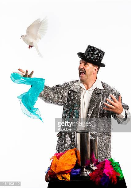 Magician freeing dove