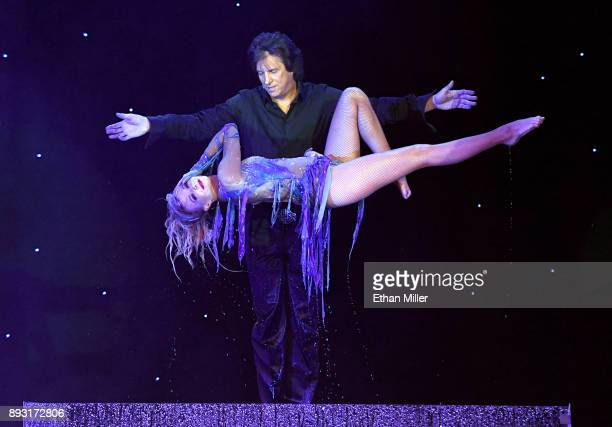 Magician Greg Gleason and Stacey Smithson perform during opening night of Masters of Illusion at Bally's Las Vegas on December 13 2017 in Las Vegas...
