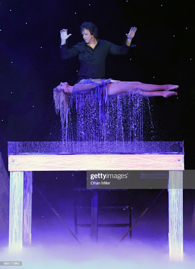 Magician Greg Gleason (above) and Stacey Smithson perform during opening night of 'Masters of Illusion' at Bally's Las Vegas on December 13, 2017 in Las Vegas, Nevada.