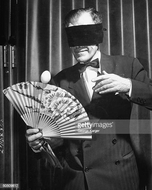 Magician Harlan Tarbell blindfolded balancing egg on a fan at Magicians Convention