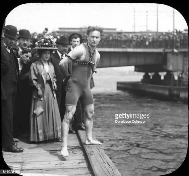 Magician Harry Houdini jumps from Harvard Bridge Boston Massachusetts April 30 1908