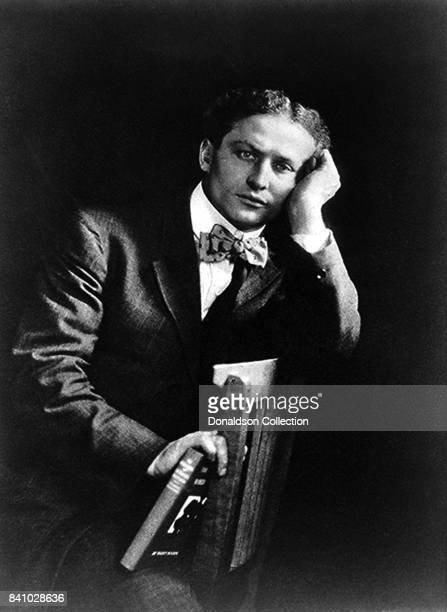 Magician Harry Houdini poes for a portrait in 1908