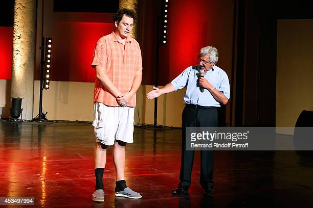 Magician humorist Eric Antoine and Artistic Director of the Festival Michel Boujenah perform and present the show of the 30th Ramatuelle Festival Day...
