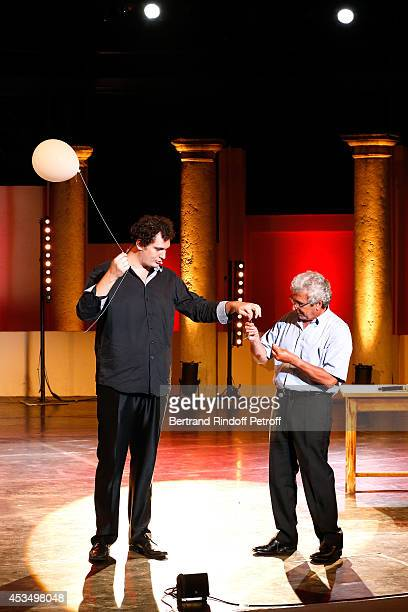 Magician humorist Eric Antoine and Artistic Director of the Festival Michel Boujenah perform and pay tribute to JeanClaude Brialy the 30th Ramatuelle...