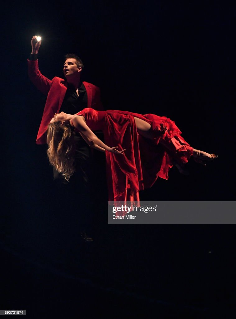 Magician Jason Bird (L) and Alison Koraly perform during opening night of 'Masters of Illusion' at Bally's Las Vegas on December 13, 2017 in Las Vegas, Nevada.