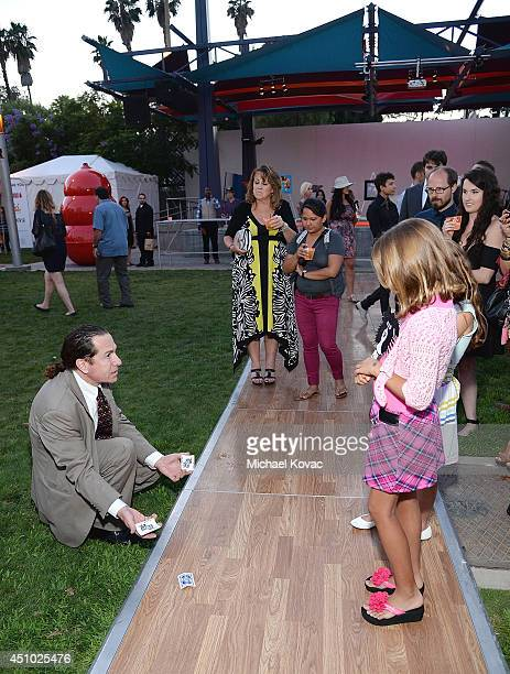 Magician Joe Monti performs at the 'More Than a Cone' art auction and campaign launch benefiting Best Friends Animal Society in Los Angeles where...