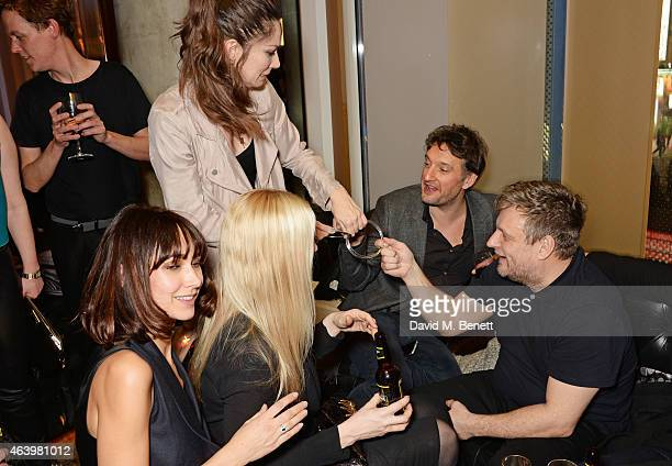 Magician Katherine Mills does tricks for guests including Chantelle Brown Tuuli Shipster and Rankin attend the launch of 'Hunger Magazine We've Got...