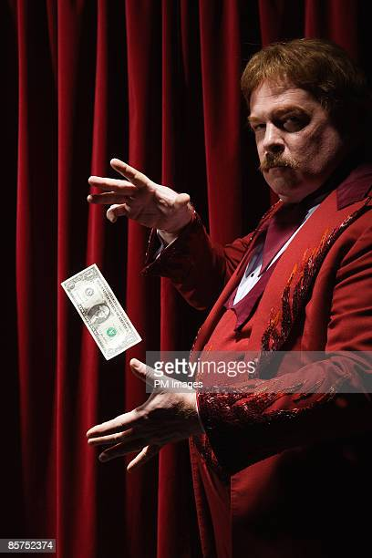 Magician levitates US Dollar.