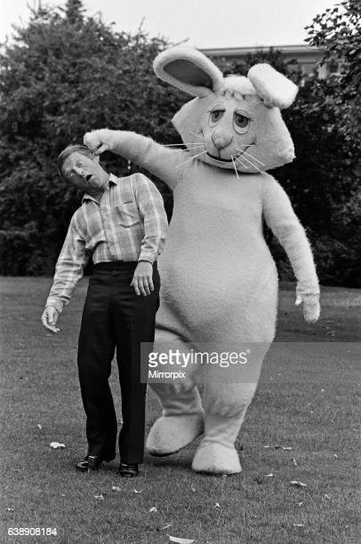 Magician Paul Daniels with his costars in the Children's BBC programme 'Wizbit' He is pictured with Wooly an eightfoot white knitted rabbit 4th...