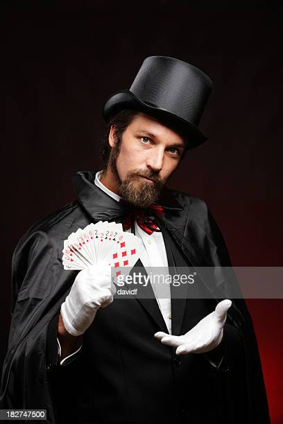 magician performing card tricks - goochelaar stockfoto's en -beelden