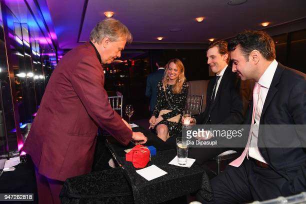 A magician performs during the Lincoln Center Alternative Investment Industry Gala on April 16 2018 at The Rainbow Room in New York City