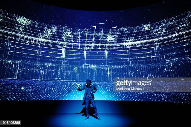 A magician performs during the opening of the Alibaba Group Showcase at the PyeongChang 2018 Winter Olympic Games on February 10 2018 in Gangneung...