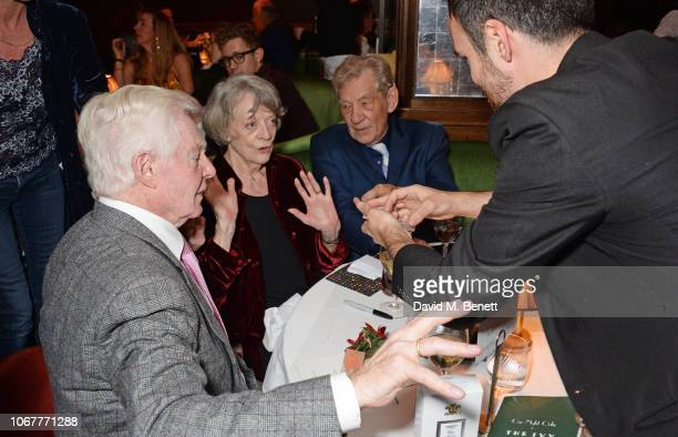 A magician performs for Sir Derek Jacobi Dame Maggie Smith and Sir Ian McKellen at the annual 'One Night Only At The Ivy' in aid of Acting For Others...