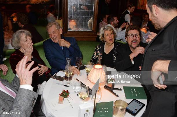 A magician performs for Sir Derek Jacobi Dame Maggie Smith Sir Ian McKellen Anne Reid and Michael Ball at the annual 'One Night Only At The Ivy' in...