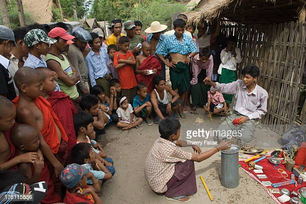 A magician performs tricks at the Taungbyon festival Every year in August hundreds of thousands of people from all over Myanmar gather for a week in...